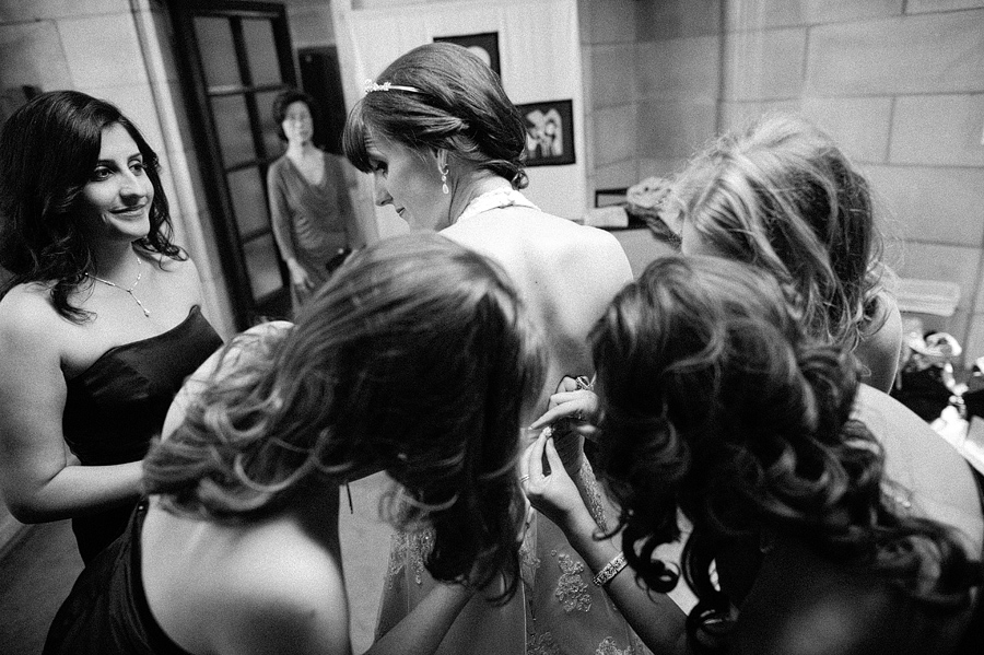 Bridesmaids help the Bride get ready at the Little Flower Catholic Church in St. Louis, Mo.